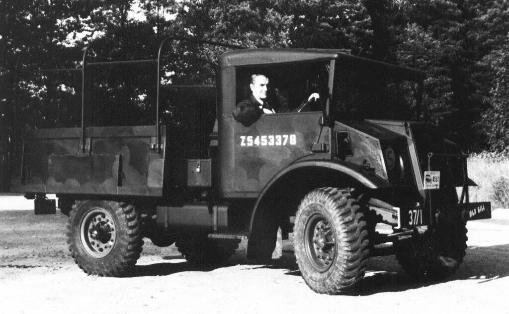 "Peter Ford at the wheel of Colin Stevens' 1943 C15 ""OLD BIL"". Original WD number Z5453378."