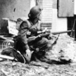 Cpl Morgan RWpgR sniper on alert Ijzendijke Netherlands 1944-10-19 to 21LAC PA-142107