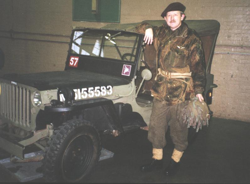 Colin Stevens with his Willys MB ex-British Airborne (1 AB Div probably post-Arnhem replacement) painted for 1 Canadian Parachute Battalion . The canvas top was not painted black as it is an original British issue one. At Beatty Street Drill Hall, Vancouver, B.C. , Canada.