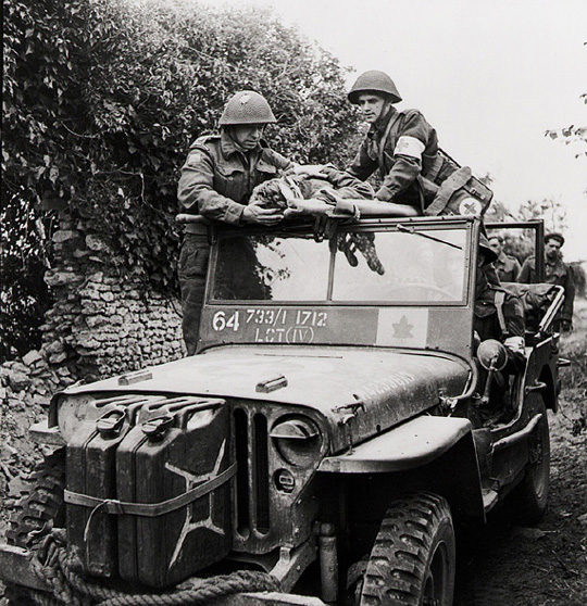 Canadian Army Ford GPW ambulance in Normandy. (Library and Archives Canada PA-140192 - cropped)