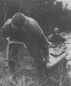 SAS or SBS canoeists armed with L34A1 silenced SMG