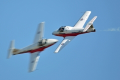 Will they or won't they? (Two aircraft from Canada's Snowbirds aerobatic team flying the Tutor aircraft.)