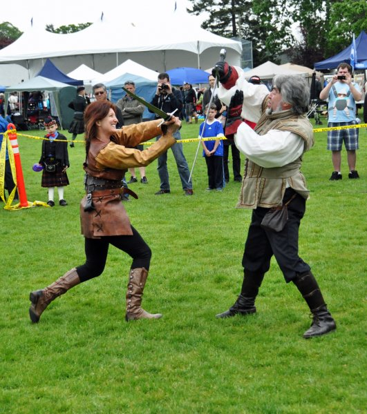 Husband and wife sorting out their differences at the Highland Games Victoria 2012 May